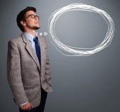 Atrakcyjny mężczyzna myśleć o mowy lub myśli bąblu z co zdjęcie royalty free
