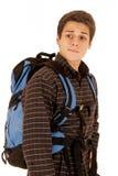 Atrakcyjny młody człowiek z błękitnego packpack intensywnym spojrzeniem Zdjęcia Royalty Free