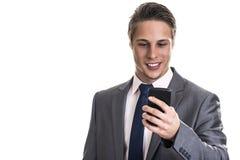 Atrakcyjny młody biznesmen na telefonie komórkowym Obrazy Royalty Free