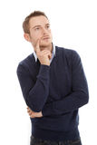 Atrakcyjny przemyślany mężczyzna - odizolowywający na bielu obrazy royalty free