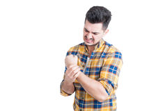 Atrakcyjny samiec model trzyma jego nadgarstek w bólu obrazy royalty free