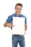 Atrakcyjny similing mężczyzna pokazuje signboard Zdjęcie Stock