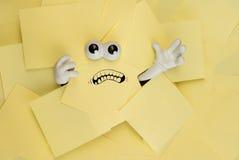 Atrapado debajo de papeleo Foto de archivo libre de regalías