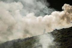 Através do fumo Imagem de Stock