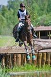 Através dos campos Cavaleiro não identificado no cavalo Fotografia de Stock Royalty Free