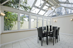 Atrium. Double glazed atrium with modern dining table royalty free stock photos