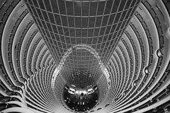 Atrium inside Jin Mao Tower, Shanghai, China. View down from the public observation deck at the 88th floor of Jin Mao tower into the 115 m high barrel-vaulted Stock Images