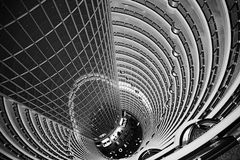 Atrium inside Jin Mao Tower, Shanghai, China. View down from the public observation deck at the 88th floor of Jin Mao tower into the 115 m high barrel-vaulted stock photography