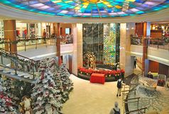 Atrium onboard Crystal Serenity luxury cruise ship. Decorated for Christmas Royalty Free Stock Photography