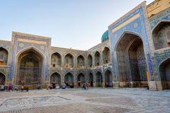 Atrium of Samarkand Registan, Uzbekistan. SAMARKAND, UZBEKISTAN - AUGUST 27: Visitors at the atrium of the Sher-Dor Madrassah in Registan,  Samarkand. August Royalty Free Stock Photos