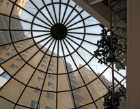 Atrium Window View. Looking up through the atrium window to apartments in the tall building outside Royalty Free Stock Photo