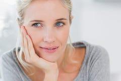 Atrractive blonde woman thinking Stock Photos