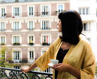 Atrractive caucasian brunette having morning coffee on the Paris Stock Photo
