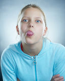 Atrractive girl making faces. Small girl making funny faces Stock Photo
