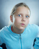 Atrractive girl making faces. Small girl making funny faces Stock Photos