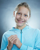 Atrractive girl making faces. Small girl making funny faces Stock Photography