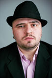 Atrractive man in black hat Stock Images