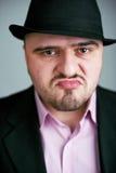Atrractive man in black hat Stock Photos