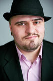 Atrractive man in black hat Royalty Free Stock Photography