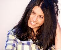 Atrractive smiling girl with brown hairs. Stock Images