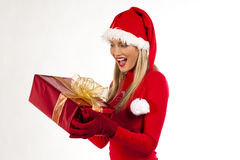 Atrtractive Santa girl with present Stock Photos