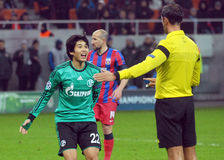 Atsuto Uchida reacts during UEFA Champions League game. Atsuto Uchida reacts after a referee decision during the UEFA Champions League game between Steaua Royalty Free Stock Images