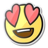 Att älska synar emojien - emoticon med ögon av röda hjärtor Arkivbild