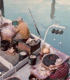 Att agna för fiskare förtjänar fiskarens hamnplats Arkivfoton