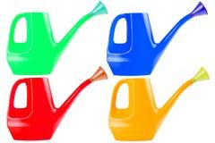 Att bevattna kan färga samlingsuppsättningen Arkivfoto