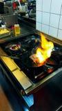 Att bränna förser med rutor Arkivfoton