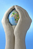 Att bry sig värld Arkivbild