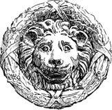 Bas-lättnad av ett lionshuvud Arkivfoton