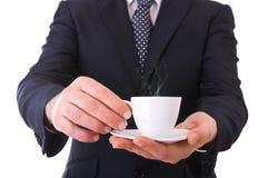 Att erbjuda för affärsman kuper av kaffe. Fotografering för Bildbyråer
