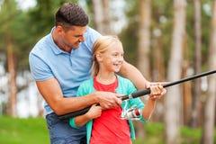 Att fiska tillsammans är roligt Arkivbild