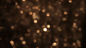 Att flimra av guld- glitter är ut ur fokus Jul bakgrund, glitter lager videofilmer