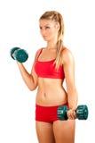 att göra kondition weights kvinnan Arkivfoto