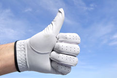 att ge golfaretecknet tumm upp Arkivfoton
