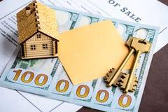 Att att köpa ett hus för miljon Förlöjliga upp med det lilla huset, tangenter, D arkivbilder