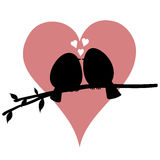Att kyssa gör en birdie på en filial Royaltyfria Foton