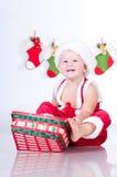 Att le behandla som ett barn Santa Claus med julgirlander Arkivfoton