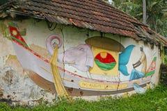 Att måla på den Varkala kusten går Arkivfoto