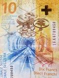 att närma sig till en schweizisk sedel av tio franc, bakgrund och textur arkivbild