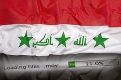 Att nedladda sparar på en dator, den Irak flaggan Arkivfoto