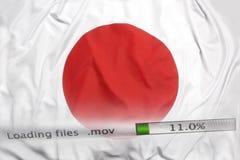 Att nedladda sparar på en dator, den Japan flaggan Royaltyfria Bilder