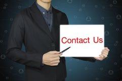 Att peka för affärsperson kontaktar oss Fotografering för Bildbyråer