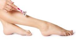 Att raka lägger benen på ryggen. fotografering för bildbyråer