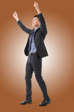 Att rymma poserar av asiatisk affärsman Fotografering för Bildbyråer