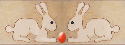 Att sitta för två easter kaniner som var motsatt, form med rad, bildade Royaltyfri Fotografi
