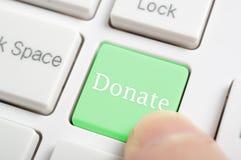 Att trycka på donerar tangent royaltyfri fotografi