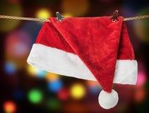 Attaccatura del Babbo Natale del cappello di Natale Fotografie Stock Libere da Diritti